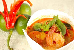 Thai red curry prawns in a white bowl - hCG diet weight loss recipe